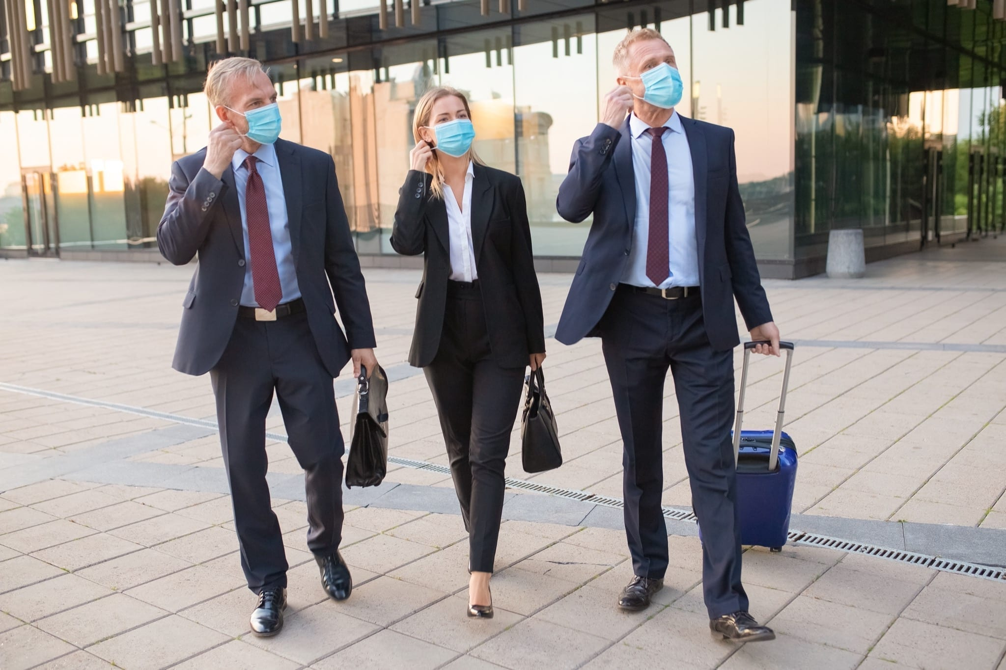 6767 copy - Business people adjusting or ready to take off face masks